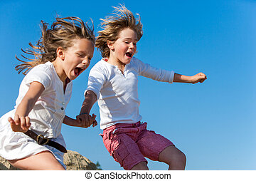 Shouting kids having fun jumping - Two kids shouting and...