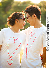 Couples in love outdoor - Happy Young Adult Couples in love...
