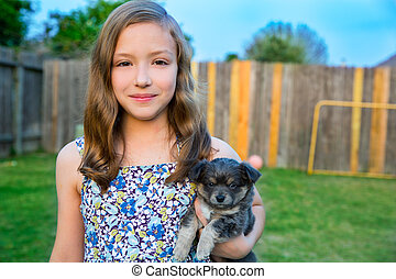 Beautiful kid girl portrait with puppy chihuahua doggy -...