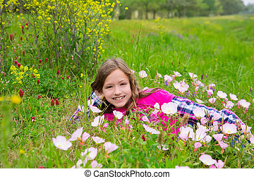 Happy relaxed kid girl on a spring flowers meadow - Happy...