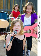 children singer girl singing playing live band in backyard -...