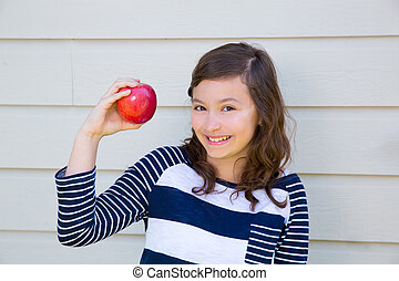 Teenager girl happy eating an apple - Teenager girl happy...