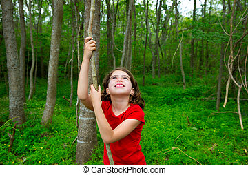 Happy girl playing in forest park jungle with vine - Happy...