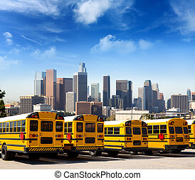 school bus in a row at LA skyline photo mount - American...