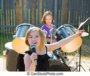 chidren singer girl singing playing live band in backyard -...