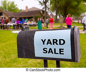 Yard sale in an american weekend on the lawn - Yard sale in...