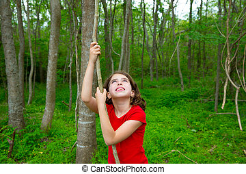 Happy girl playing in forest park jungle with vines - Happy...