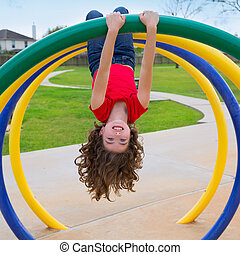 children kid girl upside down on a park ring - children kid...