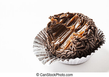 Brigadeiro bitten, a brazilian sweet, on a white background