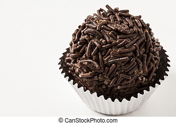 Brigadeiro a brazilian sweet, on a white background.