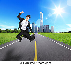 Excited Business man jump and run on the road with city...