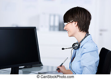 Young woman - Young happy woman working in front of computer