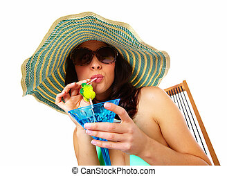 Woman drinking a cocktail Summer exotic vacation