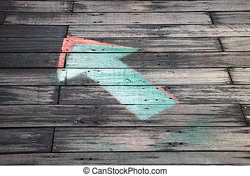 arrow on wooden floor showing direction