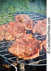 Roasting steaks on bbq