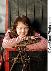 Pretty young girl in the stable - Portrait of a pretty young...