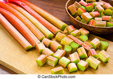 Rhubarb - Chopped rhubarb on wooden board