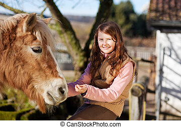Portrait of a young happy girl and her horse