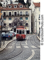 Historic streetcar in Alfama Lisbon - Historic red tram or...