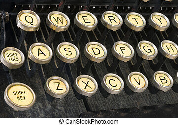 Vintage QWERTY - closeup of a vintage keyboard, showing...