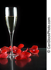 champagne glass with petals of rose