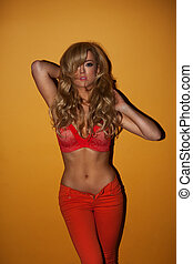 Beautiful blond woman in a sexy pose dressing red -...