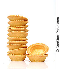 A stack of empty tartlets on white background