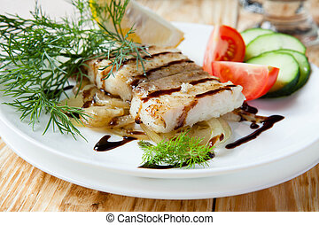 grilled fillet lemon sole with onion, food closeup