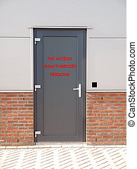 metal door with text no access unauthorized persons and...