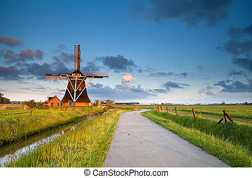 charming windmill in morning sunshine - charming Dutch...