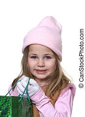 Little girl giving Christmas gift