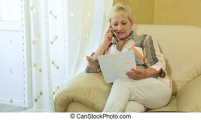 woman with financial document - Mature woman with financial...