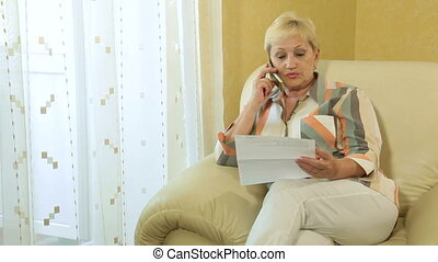 Mature woman doing paperwork