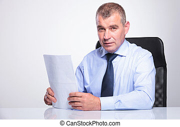 old business man sits at desk with documents - senior...