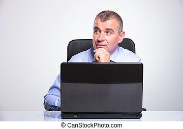 senior business man is pensive at laptop - senior bussines...