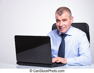 old business man working on laptop - senior bussines man at...