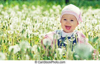 happy baby girl on meadow with white flowers on the nature -...