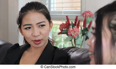 Two Asian Ladies Talking At Work - Two attractive Asian...