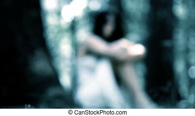 Dream sequence of woman in woods