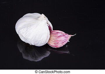 Garlic bulb split open - A garlic bulb with two cloves split...