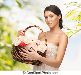 woman with basket full of flowers