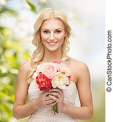 woman with bouquet of flowers - close up of young woman with...