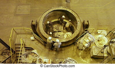 Lifting round billets - Workers lined with refractory ladle...