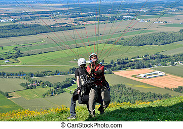 Paragliders taking off - Tandem paragliders ready to take...