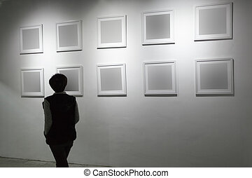 blank frame in art gallery - art gallery, girl look at the...