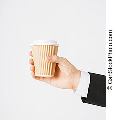 man hand holding take away coffee cup