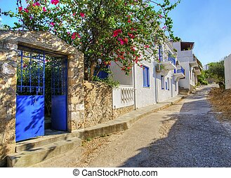 Greek island alley - A picturesque alley on the Greek island...