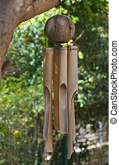 Bamboo Wind Chimes in an Olive Tree - Coconut / Bamboo Wind...