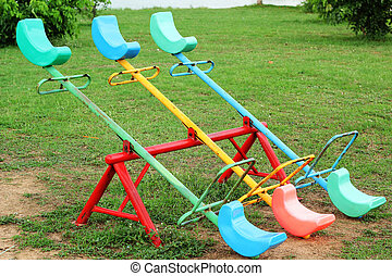 A playground - wooden rocking.