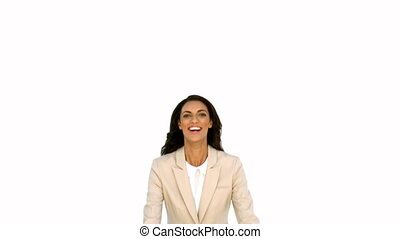 Businesswoman jumping in front of t